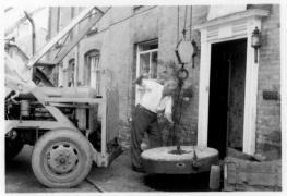 Bertie Bowen installing mill stone in front of Market Place House