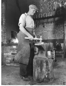 Arthur Reeve in his forge